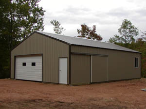 Brown storage shed with two-window garage door.