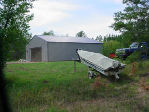 Storage shed for your boat and lawn equipment