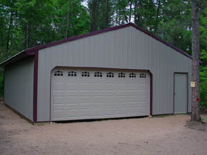 Tan pole building with red trim