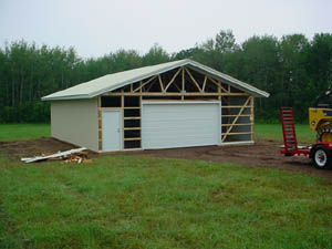 Progress of building a pole building garage