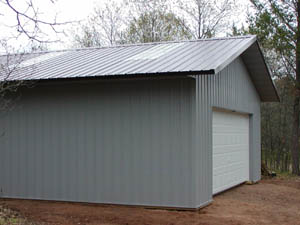 Gray tone pole shed with garage door